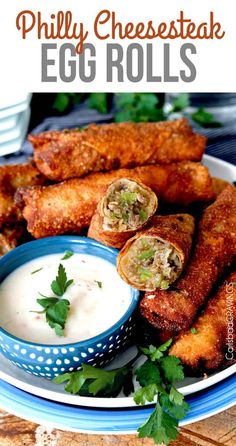 Philly Cheesesteak Egg Rolls loaded with thinly sliced marinated steak, bell pep. - Appetizers and snacks - Egg Rolls Philly Cheesesteak Egg Rolls Recipe, Chicken Philly Cheesesteak, Philly Cheesesteaks, Slow Cooker Barbecue Ribs, Shrimp Egg Rolls, Steak Rolls, Football Party Foods, Chicken Spring Rolls, Egg Roll Recipes