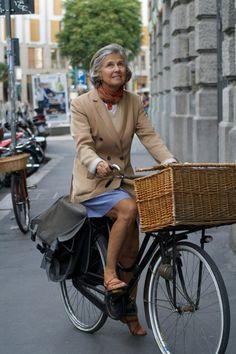 On a bike.
