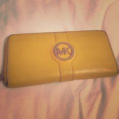 MICHAEL KORS WALLET Michael Kors wallet in mustard yellow! Gently used but fully functional. Michael Kors Bags Wallets