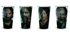 If you love a tipple whilst watching The Walking Dead then this awesome Pint Glass set is for you! Features imagery of Rick and Daryl on separate glasses along with two glasses featuring zombie walkers, each with the Walking Dead logo on the back. A great gift for any fan of this cult TV show.