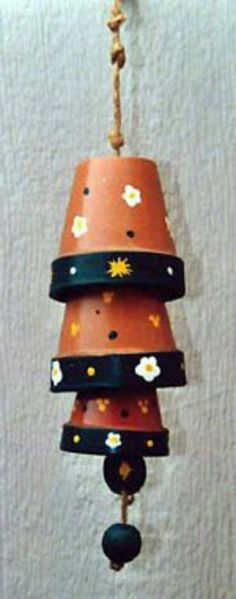 Clay Pot Wind chime - http://www.crafterslovecrafts.com/clay-pot-wind-chimes.html