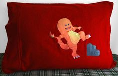 "The Charmander (Charzilla) Pillowcase! Fits Standard and Queen sized pillows. This Pokemon pillowcase features a heat transfer on ""Chilli Pepper"" flannel fabric."