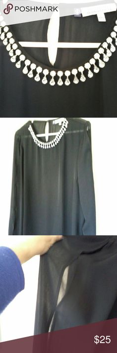 Dazzling Jennifer Lopez Blouse Rhinestone Neckline Bought it, then wore something else,  new but no tags.  Over 50 round and pear shaped rhinestones at the neckline,  sheer flowy black fabric.  Sleeves have open spaces all down the outer side,   modified cold shoulder. Jennifer Lopez Tops Blouses