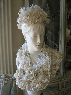 A lady bust like mine decorated with sea shells. Pretty!