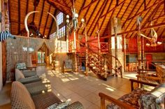 Hear the Lion Roar and the Trumpeting of the Mighty Elephant… This African Thatch Lodge in the heart of Gauteng, the economic hub of Africa is only minutes away from Sandton City, Monte Casino, Lanseria International Airport and the Gautrain International Airport, In The Heart, Property For Sale, Lion, Elephant, African, Homes, Home Decor, Leo