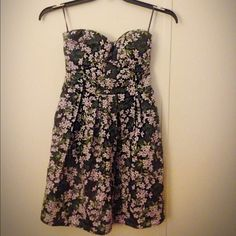 Rue 21 strapless dress It has stretch in the back and it is a large but fits a medium I just bought it a month ago for my sister but it didn't fit her and she had taken out the tag so it is brand new  it is a size large 12/14 but fits a medium 10 Rue 21 Dresses Strapless