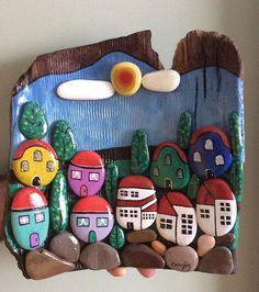 Ahşap üzerine taştan evler. #taş #stone #stonepainting #taşboyama #ahşap #rengarenk #köy #village #drawing #manzara #nature #doğal #hediye #gift