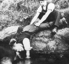 Tour Scotland Photographs: Old photograph of men guddling for trout in the River Tay in Highland Perthshire, Scotland.
