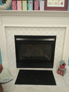 My Revamped Fireplace! I Tiled Over The Builder Grade Tiles With Arabesque  Tiles.