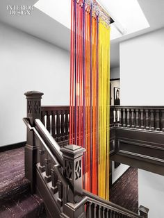 chromatic rope descends through stairwell