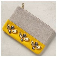 "{Anthropologie} Gem Drop Pouch {Anthropologie} Gem Drop Pouch by Shiraleah. Gorgeous yellow and grey. Wool with polyester lining. Plastic and glass jewel detail. Top zip closure. 6"" H x 9"" W x .5"" D. New in package. Never used. Anthropologie Bags Clutches & Wristlets"