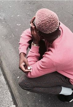 This Paris model is the poster boy for wearing pink.