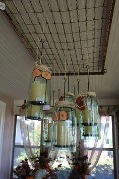 mattress spring attached to ceiling w/mason jar candles/lights hanging from it