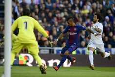 """Barcelona's Brazilian midfielder Paulinho (C) vies with Real Madrid's Brazilian defender Marcelo in front of Real Madrid's Costa Rican goalkeeper Keylor Navas during the Spanish League """"Clasico"""" football match Real Madrid CF vs FC Barcelona at the Santiago Bernabeu stadium in Madrid on December 23, 2017.  / AFP PHOTO / JAVIER SORIANO"""