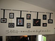 Cute idea to hang pictures from curtain rod
