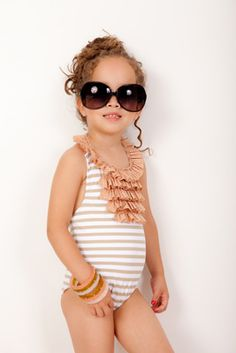 See little girls can still rock a cute 1 piece- no need for the two pieces :)
