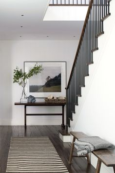 At a home in Sagaponack, New York, the original wood floors are a contrast to its stark white walls.
