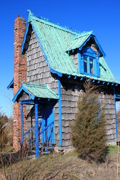Cottage at Red Oak II, near Carthage, MO. The other side of the house has a tiny porch, and it sits right on the edge of a lake. To view, go to  http://redoakiimissouri.com/index/red-oak-ii-missoura/red-oak-ii-slide-show/index.html
