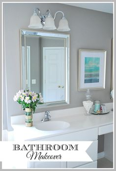 Simple, cosmetic updates like new paint and smaller decorative mirrors can make a big difference in a builder-grade bathroom and don't cost a fortune. See the whole room here. (paint color is Functional Gray SW).