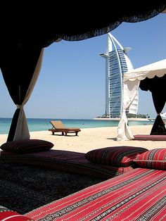 Dubai Beach with Burj hotel - remembering my trip here.  Went to the Burj for cocktails. Out of this world!!