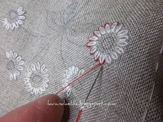 3 of 5 Lavender and Lilac. Petals are detached chain stitch (lazy daisy stitch) in 3770 dmc. Petal points are very short stemmed fly stitch in 3777 dmc.