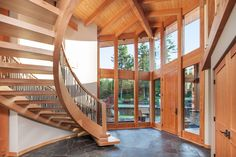 STUNNING ENTRANCE - Artistic detailing pervade every part of the home, take a look at these gorgeous stairs. | 6540 Eagles Drive, Courtenay BC #WestCoast #Architecture #Interiors