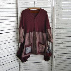 Maroon V-neck Cardigan sweater was used for the bodice of this up-cycled tunic. The sweater is a ribbed knit and has a lot of stretch, fits sizes