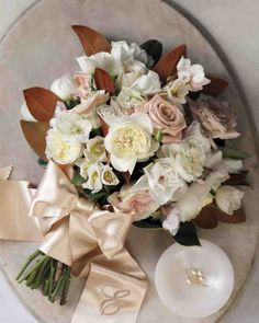 One-Shade Wonders | Hellebores, iceberg roses, and spray roses with magnolia leaves