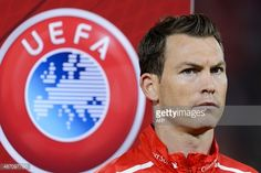Swiss defender Stephan Lichtsteiner stands during the national anthem prior to the Euro 2016 qualifying football match between Switzerland and Slovenia at the St. Jakob park stadium in Basel on September 5, 2015. Switzerland defeated Slovenia 3-2. AFP PHOTO / FABRICE COFFRINI