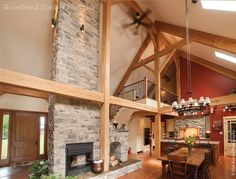 Timber framing helps define areas in this open barn home. Custom Home Designs, Custom Homes, Custom Design, Energy Efficient Homes, Timber Frame Homes, Classical Architecture, Great Rooms, Floor Plans, Farmhouse