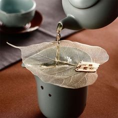 Bodhi Leaf Tea Strainer - ApolloBox A delicate and elegant way to enjoy a cup of soothing tea. Made from a real bodhi leaf, this nature-inspired Tea Strainer filters perfectly for a smooth, debris-free brew. Creative designGreat gift for tea lovers Tea Strainer, Tea Infuser, Matcha, Topping Für Cupcakes, Bodhi Leaf, Chinese Tea Set, Small Tea, Buy Tea, Deserts