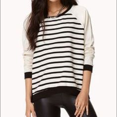 F21 Crewneck Sweater Only worn once. Black and cream with cute button accent! Forever 21 Tops