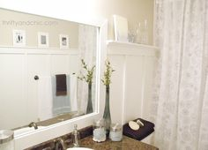 How to frame your boring builder grade bathroom mirror.  Good tutorial - she also did board and batten trim.  white bathroom