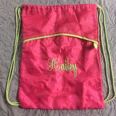 Thirty One Draw-string Backpack This would make a great gift (for someone named Hailey of course, or if you know how to take out the stitching!) This is in pristine condition as it has been used at most, two times. Very durable and would be great for the beach! Thirty One Bags Backpacks
