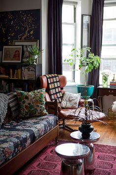 Vintage boho- reminds me of the apartments I grew up in in NYC in the 70s and 80s. Not this fancy ship you see now. Artistic, free, unique.
