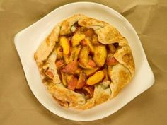 Fresh Peaches and Cream Rustic Pie from CookingChannelTV.com Be sure to add some ground ginger to the spices--cinnamon, nutmeg, ginger--and even a touch of almond extract--lost my original recipe but this is close--I omit the egg wash and sprinkle with sugar--could do both!!!
