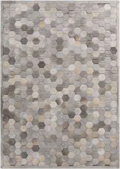 Complete any setting with this casual area rug. Hand-Knotted with 100-percent viscose, this geometric designed rug is sure to be the accent you've been searching for. Primary materials: 100-percent ha