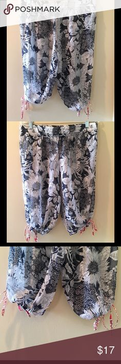 Liberty of London Target Sheer PJ Bottoms Excellent condition with no signs of wear. Sheer material with sunflower/floral design. Colors are navy and white. Cropped style pajama bottoms with ties at the knees. Very lightweight--can be worn over bathing suit at the beach/pool. Elastic waistband. 100% polyester. Liberty of London Target Intimates & Sleepwear Pajamas