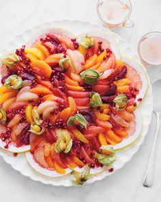 """Martha says, """"This is just multiple colors of oranges and grapefruits on thinly sliced pomelos -- I'd never done that before, but it just occurred to me how pretty that would look as a base, and I had to try it."""""""