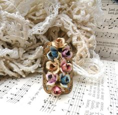 wide flower ring assemblage summer pastel by lilyofthevally