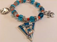 A personal favorite from my Etsy shop https://www.etsy.com/listing/252341095/miami-dolphins-hancrafted-bracelet-nfl