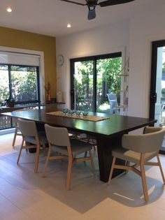This is my Tasmanian Blackwood table with Italian Billiani grey leather chairs.