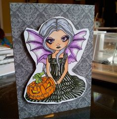 This is an adorable card created using a Jasmine becket-griffith rubber stamp available at jessica lynn original. Com we will be doing pre orders for the stamp and it will be launching officially mid August. #gothic #halloweenhorrornights #hhn #halloween #jasminebecketgriffith #jlostamps #jessicalynnoriginal #jlmould #batman #happyhalloween #hauntedmansion www.jessicalynnoriginal.com