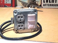 Hooking a motion sensor up to a quad-outlet.  Love that it already looks half-way Dieselpunk!