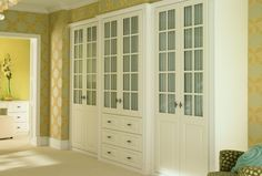 Classic bedroom furniture and wardrobes with glass shelving units incorporated into the design to aid with storage. http://www.sharps.co.uk