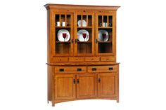 With special features like touch-switch lighting, soft-close drawer glides, and walnut inlays, this mission hutch will be treasured for years.