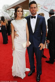 Flaunting their new love: Spencer Matthews didnt seem to mind posing with Lucy, who he recently started to date on the reality TV show as Louise stood nearby