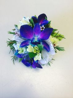 Teal/purple orchid with green hydrangea wrist corsage