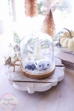 This Christmas season the crafting doesn't have to take a lot of time or make a mess - try make a cloche snow globe, with a cheese cloche, faux snow and Christmas village pieces!