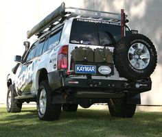 Nissan GU with Rear Step/Bar Dual Jerry Can Holder and Wheel Carrier Nissan 4x4, Nissan Xterra, Best 4x4 Cars, Patrol Gr, Jerry Can, Nissan Patrol, Can Holders, Carry On Bag, Toyota Land Cruiser